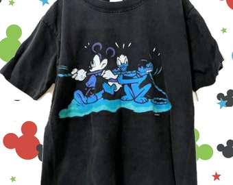 3901ba1ae3db 1990s Vintage Kids Disney Tug of War Graphic T-Shirt   Mickey Unlimited    Donald Duck   Child's T-Shirt