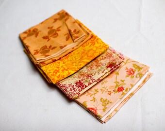 Four fat quarters flower pattern yellow,pink,orange type fabric