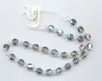 "One strand vintage Swarovski ""starlight cristal Modell No. 5"" round faceted beads"