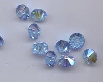 Twelve rare vintage Swarovski crystal beads: Art. 42/5307 - 10 mm - aqua AB