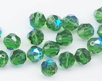 12 vintage Swarovski crystals - art 5000 - 8 mm - discontinued color green turmaline AB