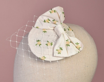 Retro Bow Fascinator in Ivory Satin Rose Design with Veil