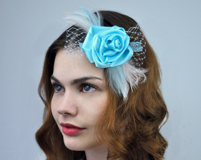 Flower and Feather Hair Clip Fascinator in Pastel Blue with Net Veil Detail