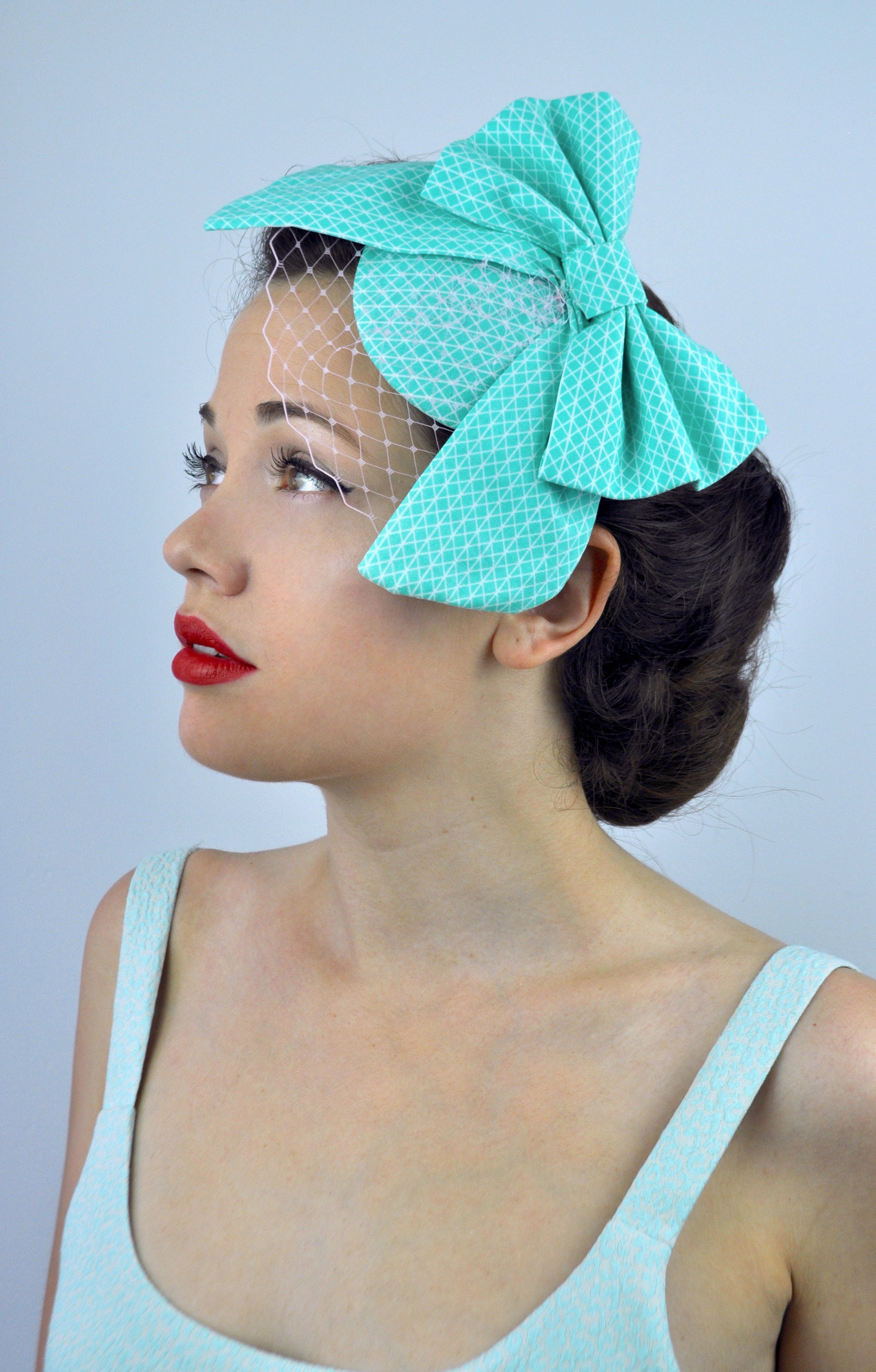 Mint Green Geometric Print Bow Fascinator with Pastel Pink Net Veil ... 2009b1a405e
