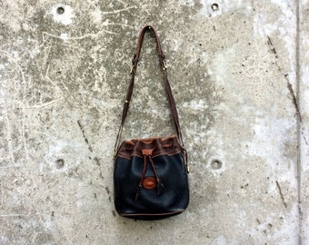 All Weather Leather -- Blue and brown leather Dooney & Bourke crossbody bucket bag -- Made in the USA