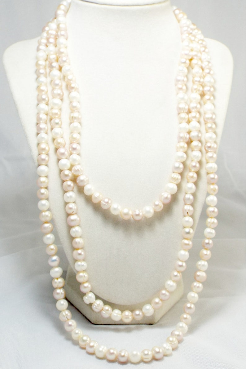 Endless Strand of Natural Ivory Pearls Peachy Ivory 68 image 0