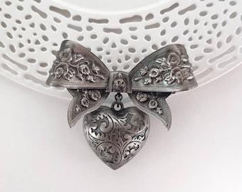 Vintage Victorian Revival Bow & Heart Dangle Brooch w/ Floral Scrollwork Design- Ornate Elegant Antiqued Silver Tone Finish