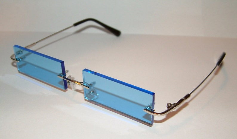 26909a9eab8 Blue streached rectangle Rimless Cosplay glasses.