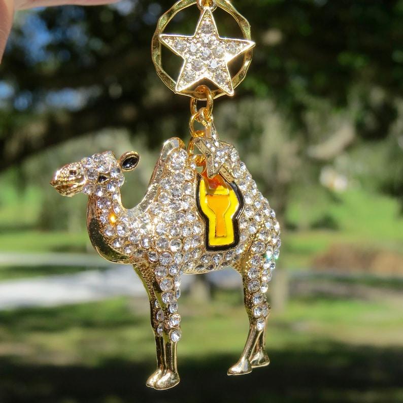 The CAMEL/'S STAR Gold Rhinestone Camel Christmas Ornament