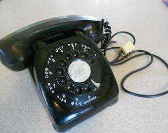 Vintage rotary monophone.  Bakelite.  Five foot cord.  Old black phone.