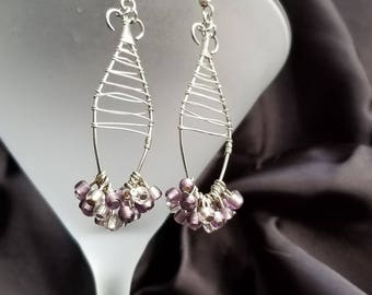 Handmade wire bent dangle earrings with violet beads