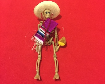 Pink Sarape day of the dead skeleton ornament with a mango #12