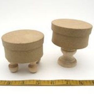 2 paper mache round boxes on feet and pedistal