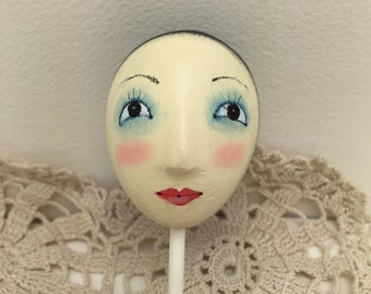 oval hand painted plaster doll  head by julie haymaker thompson