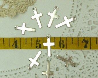 15 simple silver  tone base metal cross charms / pendantse 24 mm long with loop and 13 mm wid