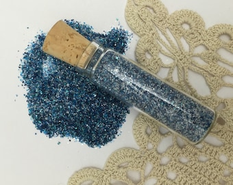 1 - half oz glass tube  filled with medium blue mixed  real silver  german glass glitter in fine.