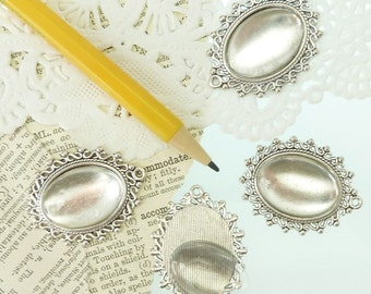 4 antique silver ornate bezel pendants with matching clear glass cabochons