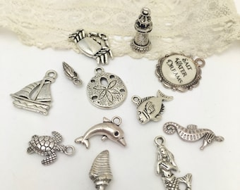 13 seaside theme charms  most double  sided  in antique silver.