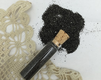 1 -1/2 oz german glass glitter - real silver base black  in glass corked vial- fine