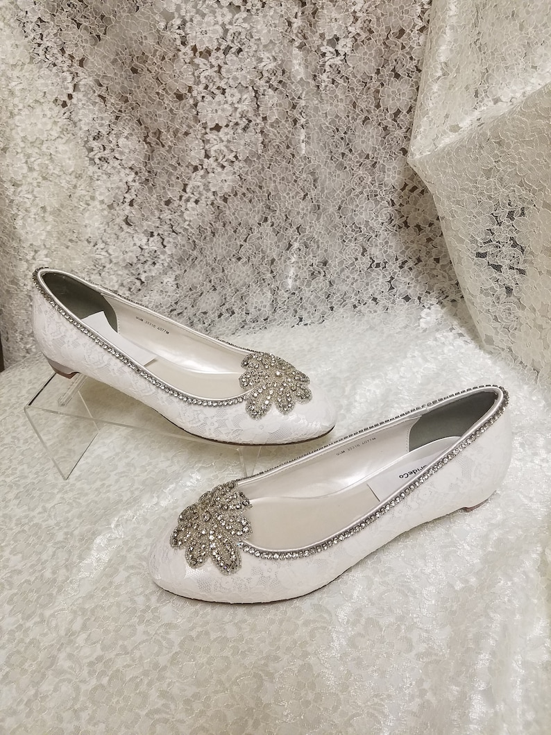 History of Victorian Boots & Shoes for Women Antique Silver Bling shoes Size 9.5 Lace OffWhite almost flat heel 1/2 inch heelLace pumpsLace shoes with Crystal embellishment. $146.00 AT vintagedancer.com
