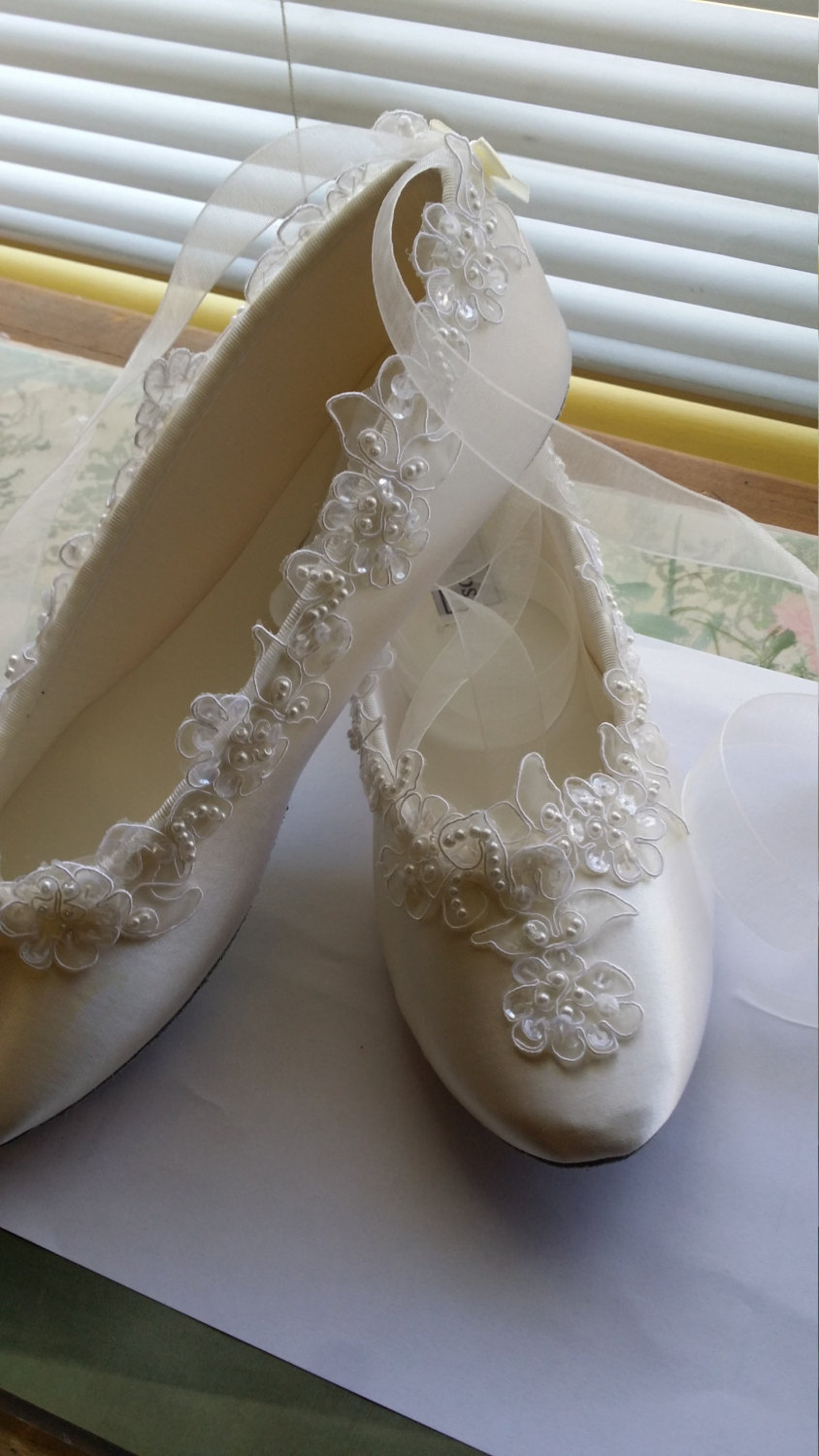 brides satin wedding flats white silver edging appliqué, white satin ballet style slippers, lace flowers all along edge. romanti