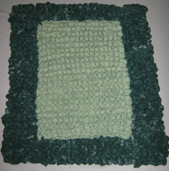 Knitted Rag Rug Made With Recycled Poly Cotton. Shades Of