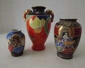 A Vintage Trio of Satsuma Vases, Mid-Century Art Pottery, Japanese Figures And Flowers, Raised Designs, Circa 1945-1952