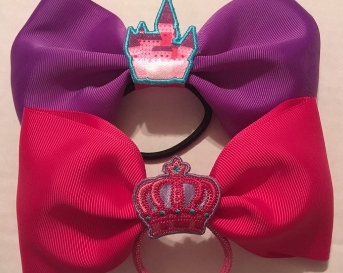 TWO Adorable princess bows in pink and purple