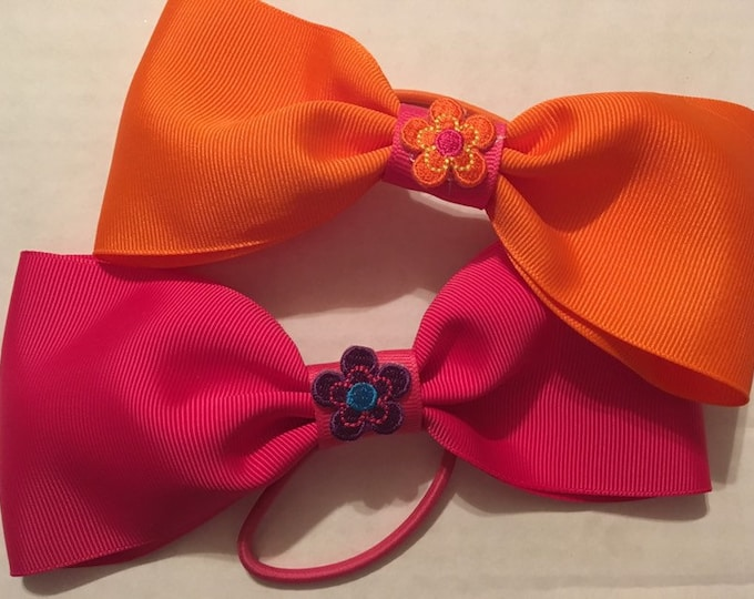 Adorable pink and orange butterfly flower princess cheer and dance bows