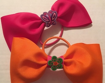 TWO adorable pink and orange tail less bows for cheer, dance, princess