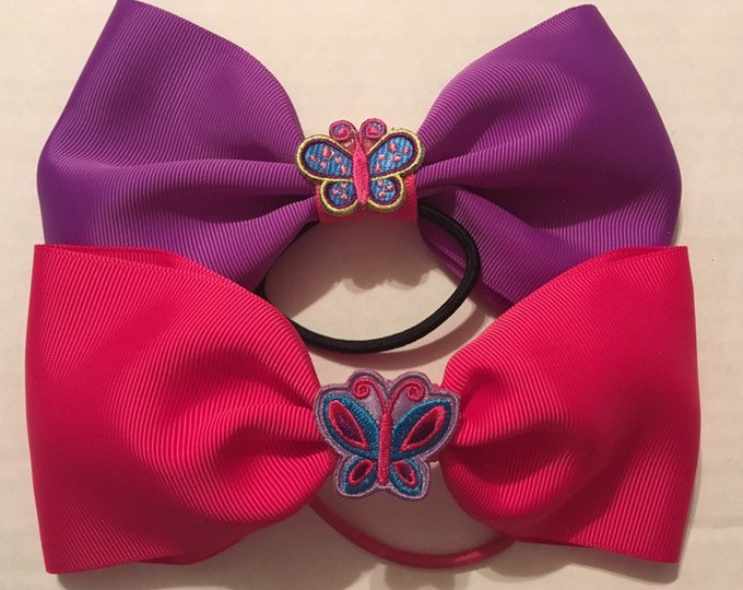 TWO adorable butterfly bows- purple and pink