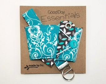 Good Day Essentials, teal, gray. reversible coffee sleeve, lip balm pocket and key chain. Mother's Day, gift, birthday
