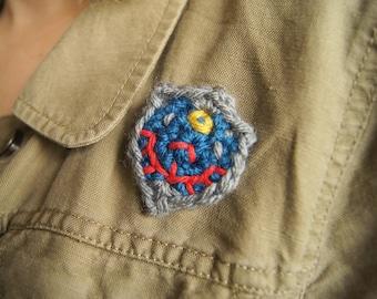 Crocheted Link's Hyrule Shield Pin from The Legend of Zelda