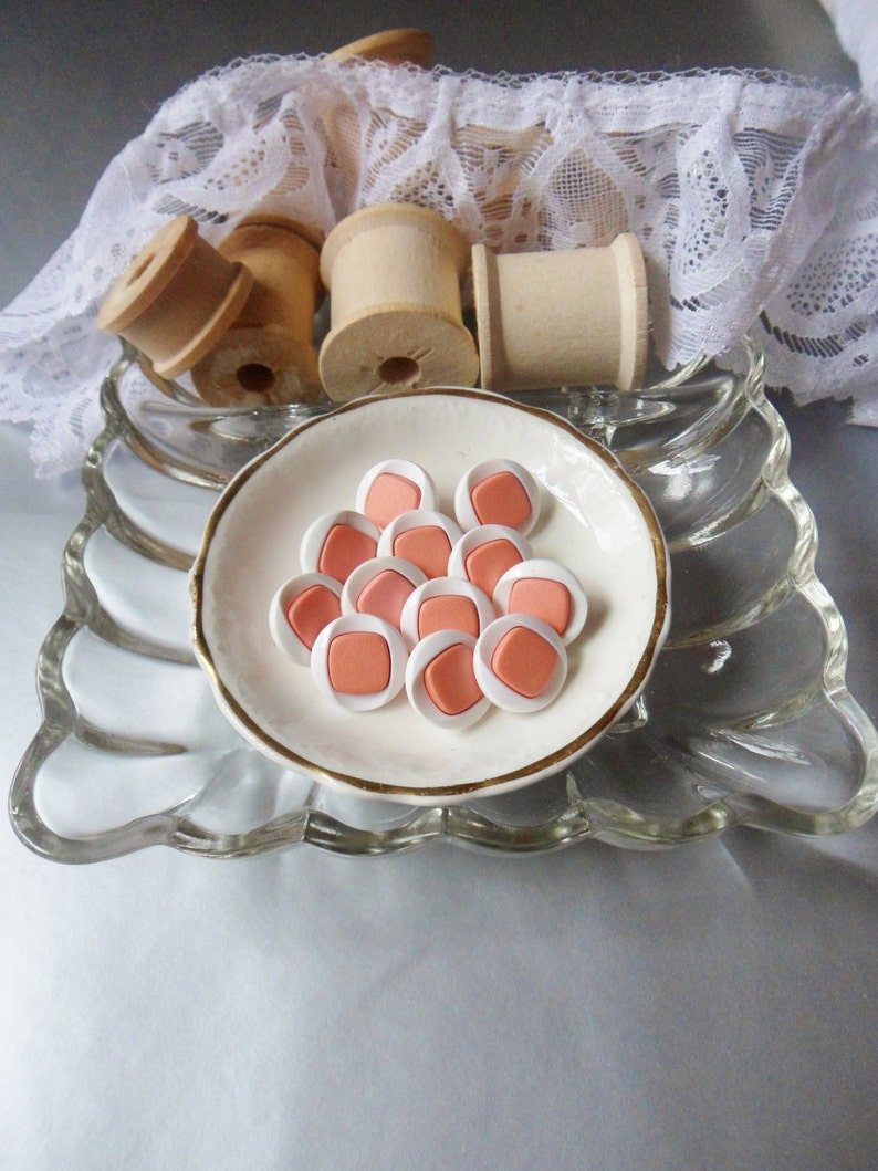 Twelve Pink and White Buttons 58 Two-Tone Buttons