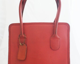 2aba988bb900 Coach- Coral Pink Leather Small Dinkey Lunch Tote with brass feet