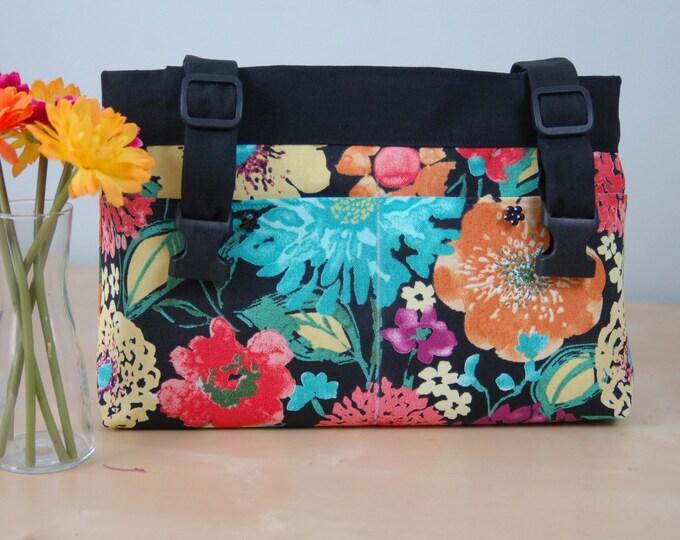Featured listing image: powerchair bag, wheelchair purse, walker organizer, wheel chair accessory: Bright and Cheerful Floral Print bag.