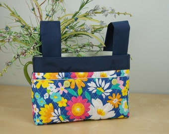 Walker Bag: Bright Floral print bag with soft green lining.