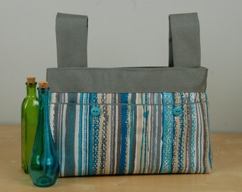 Walker Bag: Blue, Turquoise and gray striped bag with a silvery gray lining.