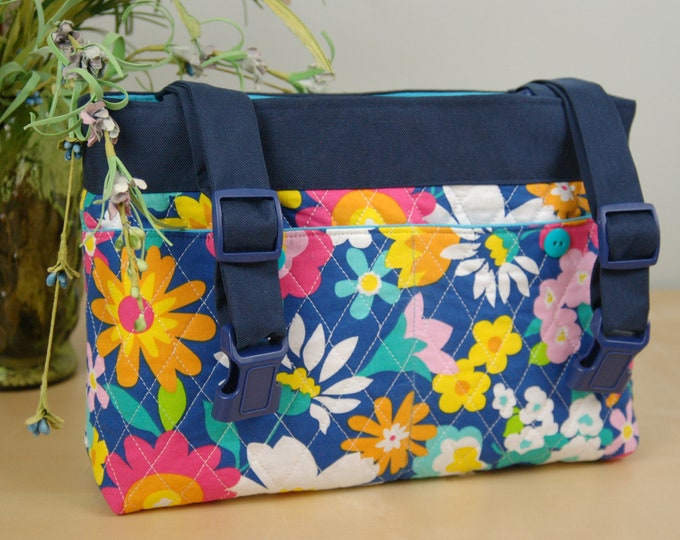 Featured listing image: Powerchair bag, Wheelchair purse, Walker Organizer, Wheel Chair Accessory - Quilted Bright Floral bag with turquoise lining.