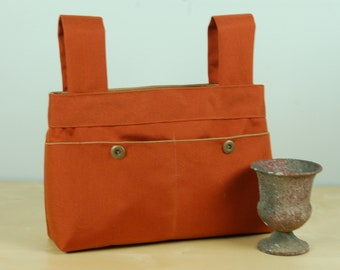 Walker Bag: Burnt Orange bag with a taupe lining.