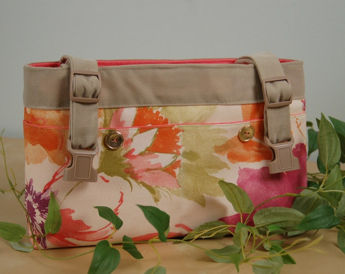 Featured listing image: powerchair bag, wheelchair purse, walker organizer, wheel chair accessory: Soft Floral print with a peach lining.