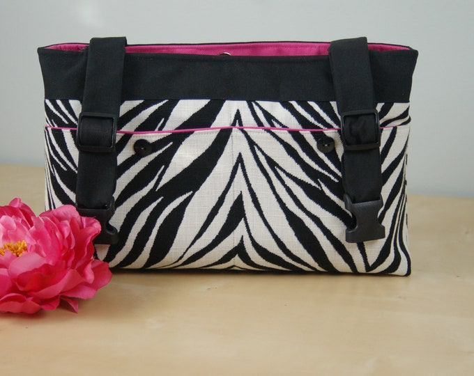 Featured listing image: Powerchair bag, Wheelchair Purse, Walker Organizer, Wheel chair Accessory - Wild Zebra patterned bag with Ho Pink Lining.