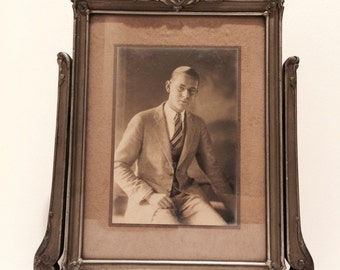 Antique picture frame on a swing stand, or swivel frame, portrait photo