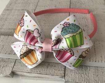 Pink headband with multicolor cupcakes on white bow, Girls/Toddlers