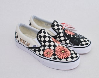 99a7f936a91 Custom Hand Painted Checkerboard Vans Slip-ons Feature Coral Daisy s with  Studio Headphones