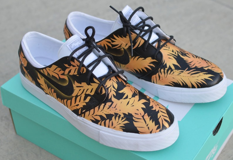 776049e15751 Custom Black   Gold Tropical Floral Nike SB Zoom Stefan