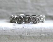 """Vintage 18K White Gold Diamond """"X"""" Hidalgo Wedding Band."""