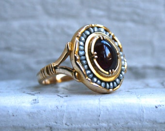 Beautiful Vintage 14K Yellow Gold Garnet and Seed Pearl Ring by the Metropolitan Museum of Art.