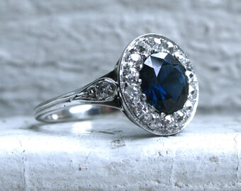 Vintage Halo Platinum Diamond and Un Heated Sapphire Engagement Ring with GIA Certificate - 3.14ct.