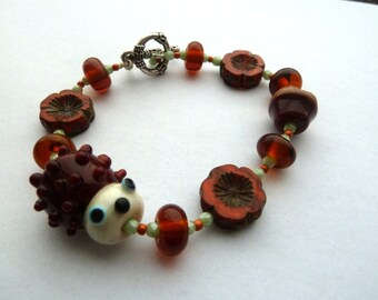lampwork hedgehog bracelet, uk handmade jewellery